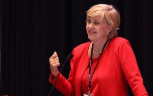 Susan Dio speaking at an industry conference
